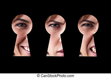 Girl eye in keyhole - Girl with different emotions looks in...