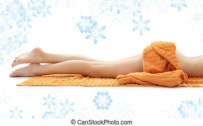legs of relaxed lady with orange towel - long legs of...