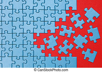 Concept missing pieces in a puzzle - A jigsaw puzzle is...
