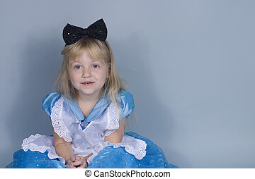 Giggling Alice in Wonderland - A little girl dressed as...
