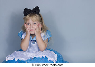 surprised Alice - A little girl in an Alice in Wonderland...