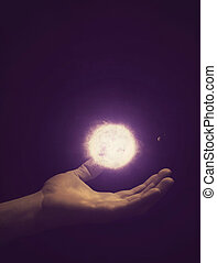 Holding the solar system. - An open hand holding the solar...