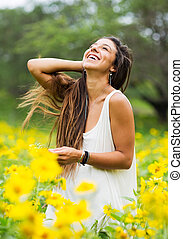 woman in field of flowers - Beautiful young woman in a field...