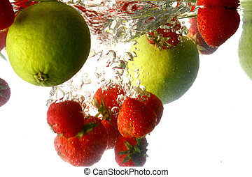 lime splash - lime and strawberry splash isolated on white...