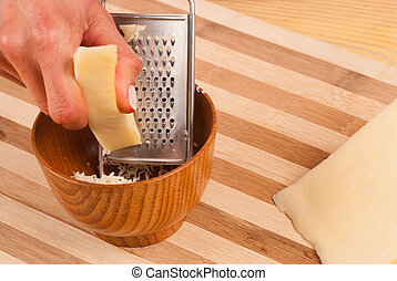 Grating cheese for the extra fresh flavor