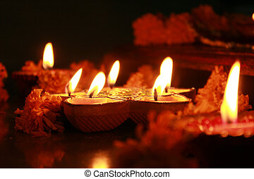 Ritual Lamps - Earthen oil lamps lit with flowers during the...