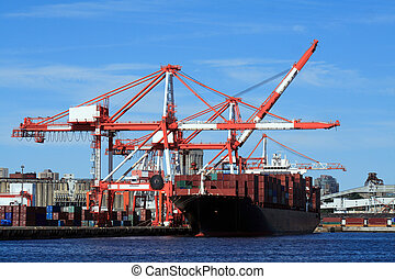 Container Ship - A container ship loading at the shipping...