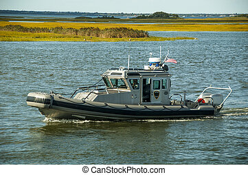 Harbor Patrol - A harbor police boat patrols the waterways