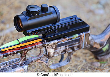 Crossbow and Arrow - A close up view of a crossbow optics,...