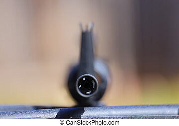 Assault Rifle - A close up view of an assault rifle pointed...