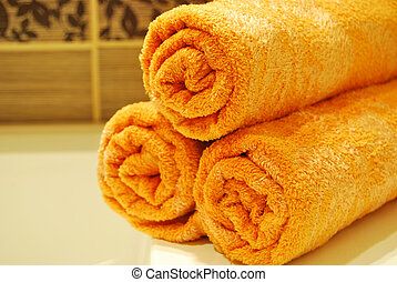 Orange Towels - A modern orange towels over the sink in the...