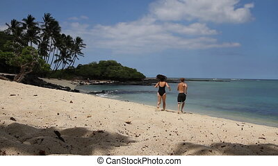 Hawaiian Beach Paradise - A couple holds hands and runs into...