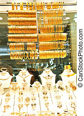 Gold jewelry in grand bazaar - Bracelets on a show window...