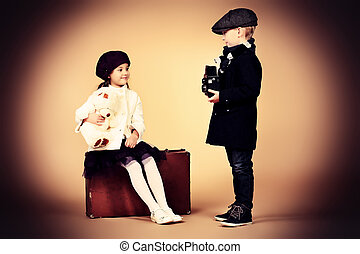 elegant couple - Cute little boy is photographing the...
