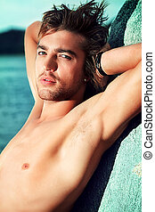 relaxing - Portrait of a handsome male model posing at the...
