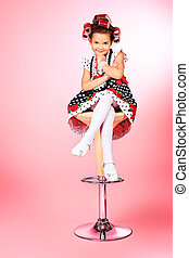 smarten up - Portrait of a cute little pin-up girl over pink...