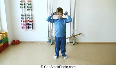 Child in the gym - Child is therapeutic exercises in the gym