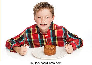 Boy eating pie - Boy eating pork pie Studio white background...