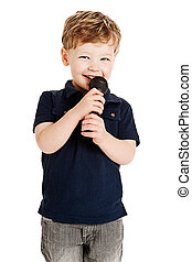 Cute boy singing with microphone shot as cutout on studio...