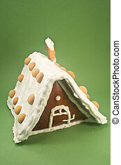 Gingerbread house on green background