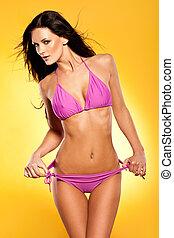 Fashion model in a pink bikini