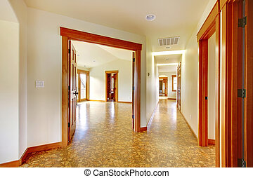 Large hallway in empty house. New luxury home interior.