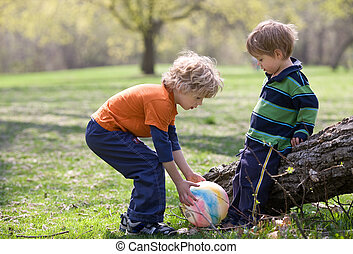 Children in park with colorful ball