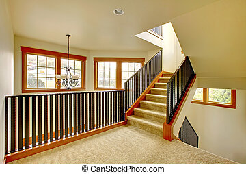 Staircase with metal railing New luxury home interior