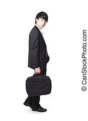 business man walking and holding briefcase, full body...