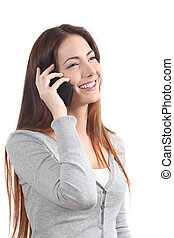 Happy redhead woman talking on mobile phone on a white...