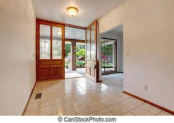 Empty front entrance with open door. Home interior. - Empty...