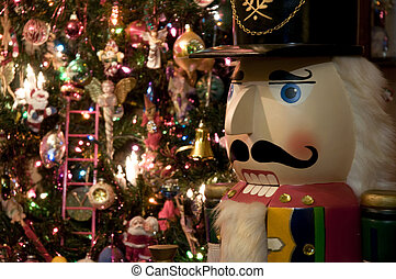 Nutcracker with Christmas Tree - Selective focus on the...