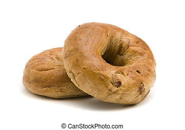 Two Cinnamon Bagels - Two cinnamon bagels on a white...