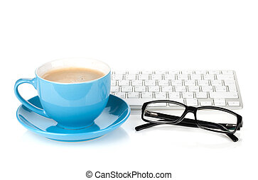 Blue coffee cup, glasses and computer keyboard