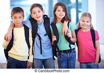 Schoolmates - Portrait of smart schoolkids standing in line...