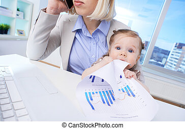 Business baby - Close-up of businesswoman at workplace...