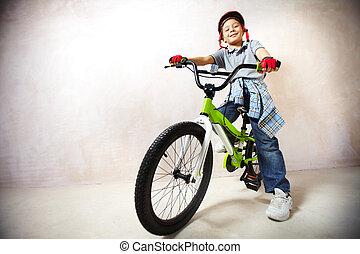 Little mountain biker - Portrait of happy boy on bicycle...