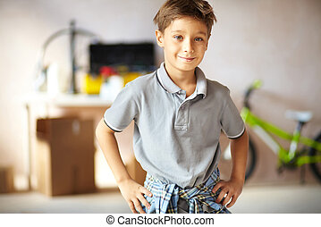 Youngster - Portrait of cute boy looking at camera in garage