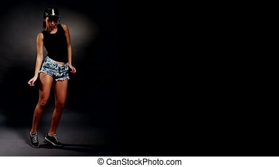 Woman hip hop dancing - brunette woman woman in shorts and a...