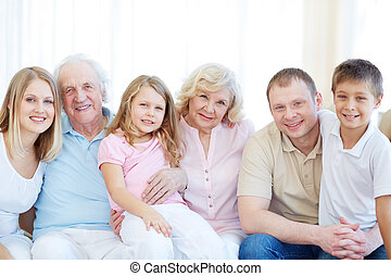 Big family - Portrait of senior and young couples with their...