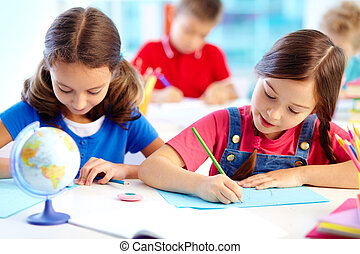 Drawing lesson - Portrait of lovely girls drawing at...