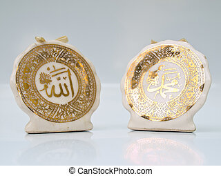 Arabic calligraphy of Allah Islamic God on the right and...