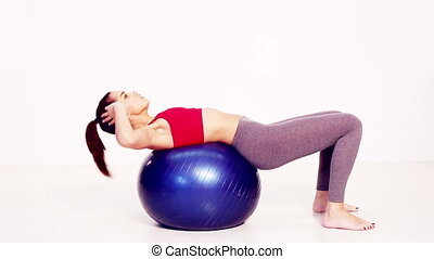 Pilates sit up exercise - Portrait of healthy woman doing...