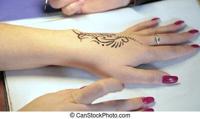 Making temporary tattoo - making temporary henna tattoo on...