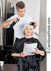 Woman Getting Her Hair Done In Salon - Senior woman with...