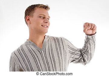smiling man showing his fist with white background