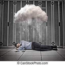 Data worker napping under cloud in data centre - Data worker...