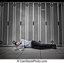Data worker asleep on floor of data centre