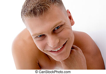 close up of smiling muscular man