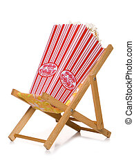 out door cinema - retro pop corn on deck chair studio cutout